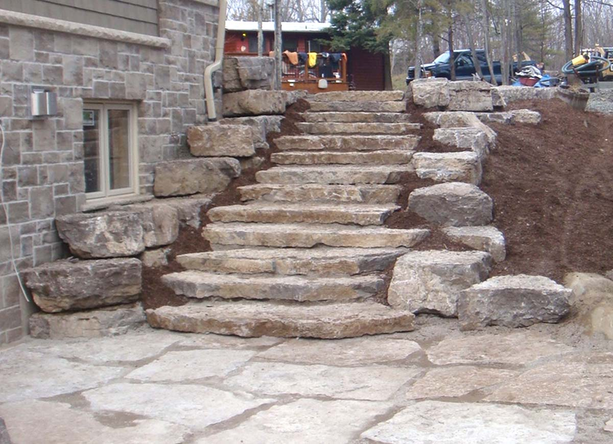 Natural stone steps retaining walls and large flagstone patios
