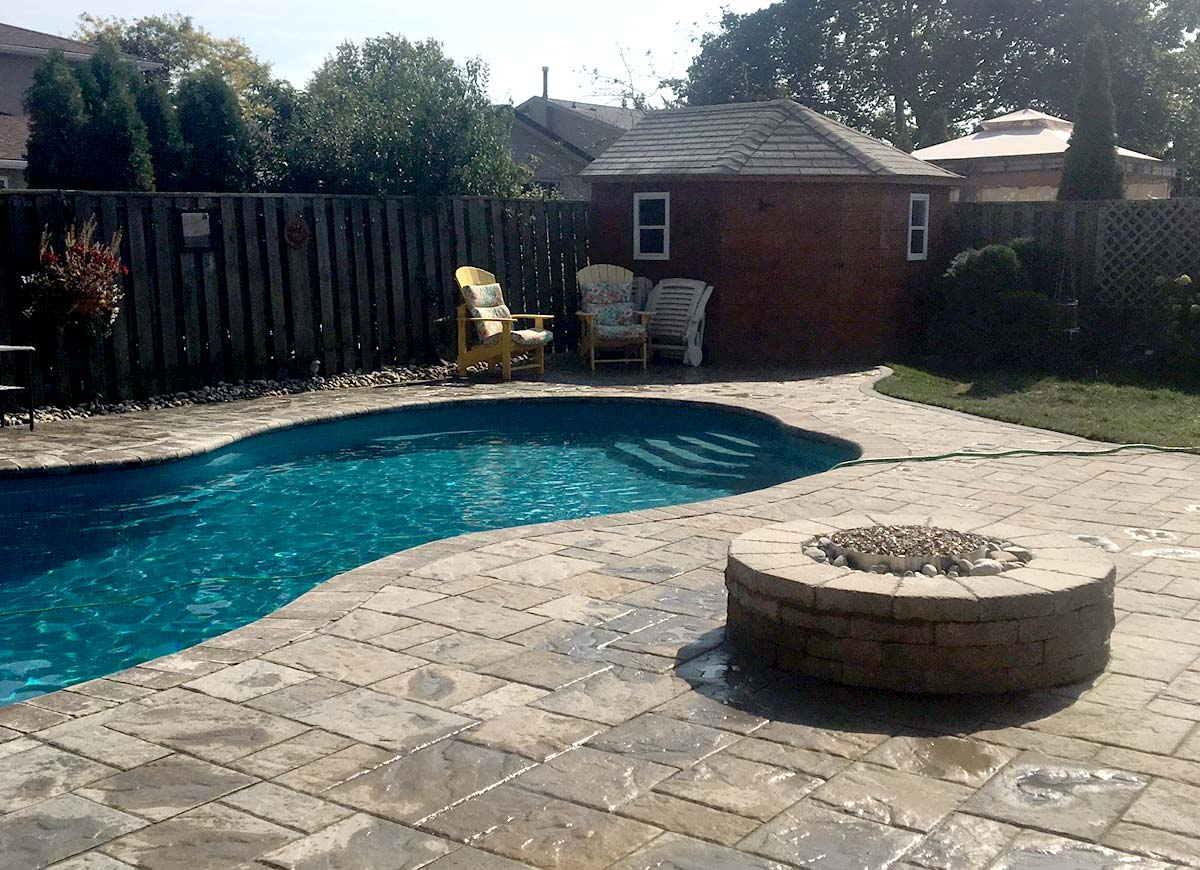 Permacon stone relay and enlarge patio add fire pit